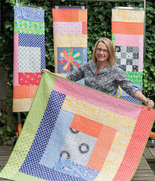 http://blog.shopmartingale.com/wp-content/uploads/2015/02/Rainbow-Round-the-Cabin-quilts.jpg